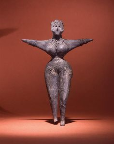 Female Figurine from Iran, 3500 BCE. adorned with jewelry. Penn museum.