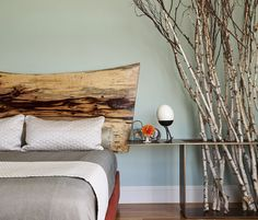 Scandinavian Style- Add some Scandinavian style chic with natural wood headboard and wooden branch decorations.