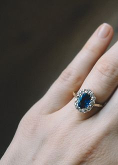 Vintage Victorian ring made in 18k yellow gold and centered with an approximately 1.20 carat natural sapphire. Accented with single cut diamonds weighing approximately .40 carats total. Circa 1890.