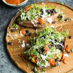 Loaded Sweet Potatoes with Quinoa Tabbouleh. Healthy and vegan, these baked…