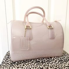 """Furla Candy Bag Large Furla Candy Satchel, Made in Italy, pink discoloration at bottom.  There are instructions for cleaning the pvc/rubber materiel online.  In otherwise beautiful condition.  Approx 11 x 9 x 7 in.  No lock buy """"candy bag"""" tag included as shown in pic 1. Furla Bags Satchels"""