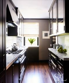 Kitchen Living Rooms Remodeling Galley Kitchen with Black Cabinets - A darker redesign just might be for you. White Galley Kitchens, Galley Kitchen Design, Galley Kitchen Remodel, Kitchen Cabinet Design, Grey Kitchens, Small Kitchens, Kitchen Renovations, Black Kitchen Cabinets, Kitchen Black