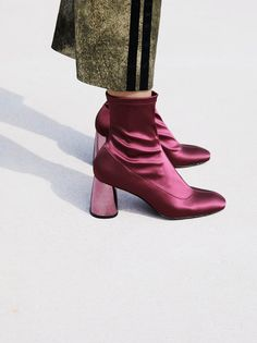 Spectrum Sock Boot | Statement pull-on ankle boots featured in a stretchy fabrication with a rounded toe and a modern mirrored heel.  * Inside zip closure * Padded footbed * Berry, Rust: Sleek stretch stain * Black, Gold: Shiny stretch lurex