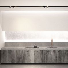 AD office interieurarchitect - branwood kitchen cabinets witch bluestone countertop and indirect lighting