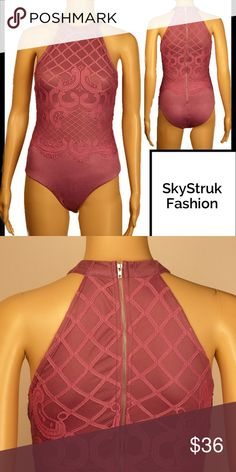 Mauve Lace Bodysuit Beautiful mauve soft and stretchy w lightweight lace on top and zipper down back . Snaps at crotch. 60% cotton, 20% polyester, 20% rayon. Due to various viewing options color shown may not be exact . Boutique Tops