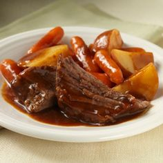 Easy Slow Cooker Pot Roast - Recipes - ReadySetEat - Sounds good. I will probably put the onion soup mix and the tomato sauce on top of the roast instead of the potatoes and then add some worcestershire.