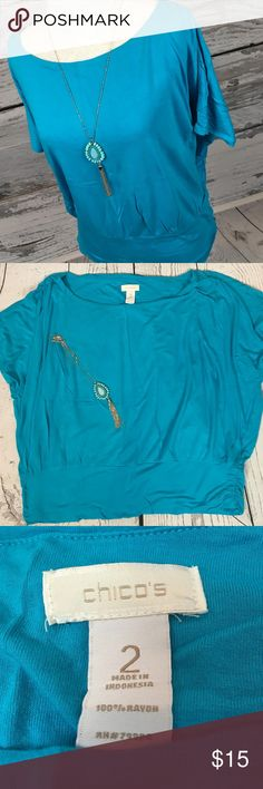 """Chico's Teal Blue Dolman Shirt Top Sz 2 12/14 Beautiful!!! Get pumped for that island vacation  I can see the water being the color of this lovely top!! Banded at waist with gathered sides & shoulders. Dolman bat wing style. Beautiful condition from a smoke free home!! Chico's Size 2 or women's 12/14.  Measurements (flat): Armpit to armpit: 29"""" Armpit to bottom: 13"""" Shoulder to bottom: 22.5"""" Across bottom: 17.5"""" unstretched Chico's Tops"""