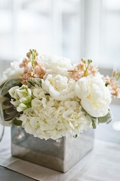 Peonies and hydrangeas in tin box as centerpieces