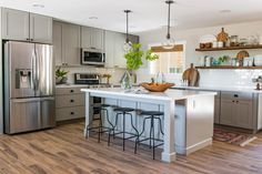 By adding a kitchen island to this kitchen, homeowners gained extra storage and…