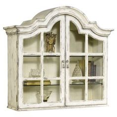 """Indulge in timeless style with this masterfully crafted design, an eye-catching addition to your home.Product: Secretary hutchConstruction Material: Wood and glassColor: Distressed whiteFeatures:  Two doorsDimensions: 36"""" H x 40"""" W x 22"""" DNote: Desk and hutch sold separately"""