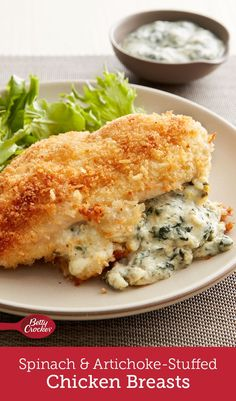 Looking for new ways to get more spinach-artichoke dip into your life? Try these crispy chicken breasts served with a creamy sauce that only takes a minute to make.