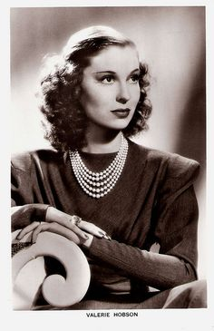 """""""Elegant, redheaded Valerie Hobson (1917 - 1998) was a great beauty who became an impressive actress. The British actress landed some very choice roles in the later 1940s, and was at her best in those films in which she could exercise her comedy talent"""