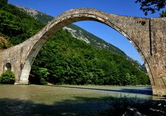 Tzoumerka,Greece. The historic stone bridge of Plaka in Arta, western Greece has been standing over Arachthos river for 148 years. It was the biggest one-stringer bridge in the Balkans. It was constructed by Constantinos Bekas in 1866.It is the widest stone-made bridge of Epirus and probably of Greece. The bridge of Plaka, is considered as the biggest single-arch bridge in the Balkans, with 40m arch span and 21m height.