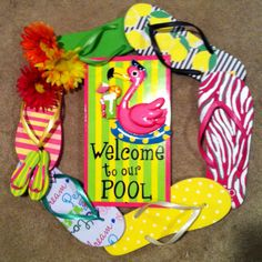 Flip Flop wreath I made for the pool. There several of these sites to explain how to make them. So easy.