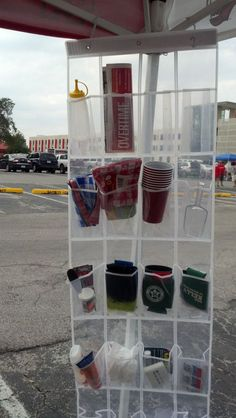 Tailgate Idea ~ Use a clear hanging shoe organizer for tailgating. Hang it on the tent canopy rails and roll it up after the game. Easy way to see where things are and what needs refilling - and frees up the table for food! Great for Camping too! Family Camping, Tent Camping, Camping Gear, Camping Hacks, Outdoor Camping, Camping Table, Camping Stuff, Camping Guide, Camping Activities