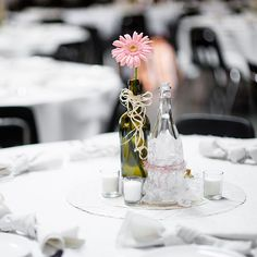 Wine bottle wedding centerpieces...But covered in sparkles and with better flowers #sparklingeverafter
