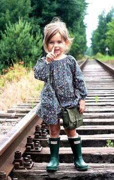 This picture is priceless... Picking her nose with her little wellies on. Awww