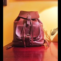 Vintage Backpack, handmade from thick cow leather. Has nice scratches, discoloration from wear and tear. Drawstring and buckle. Small pocket in front also with buckle. Flat pocket inside. Purchased in 1999. Village Tannery Bags Backpacks