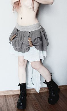ON SALE!!!  WAS -> 79 € IS -> 65 € !!!  A handcrafted mini skirt with a detachable ripped train on a zipper and decorative suspenders. One of a kind. The only one in the world like it. As unique as you!!! Partly made from BIO cotton.  Waist: 58 - 85 cm (22,5 - 33,5) Hips: up to 110 cm (43) Lenght: 36 cm (14) Lenght with a train: 87 cm (34)  FREE SHIPPING WORLDWIDE