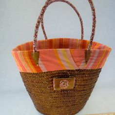 Check out this item in my Etsy shop https://www.etsy.com/listing/242569040/designer-kenyan-straw-basket-with-beaded