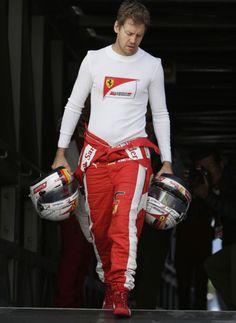 Sebastian Vettel at Monaco carrying his helmets alone.. Antti.. where are u dude?