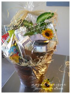 Feel better soon gift basket including bath & body products, chocolates, games and word puzzles and few of the recipients favorite things! #GetWell #GiftBaskets #Custom #LasVegas noveldesignsllc.com