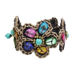 This+rustic+floral+bracelet,+made+of+mother+of+pearl,+delivers+a+rich,+bohemian+look+that+is+guaranteed+to+attract+attention.+Its+colorful+palette+makes+it+easy+to+match+with+other+accessories,+and+its+adjustable+clasp+ensures+that+it+will+fit.