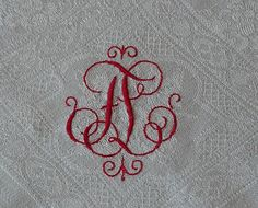 antique tablecloth with turkey red monogram