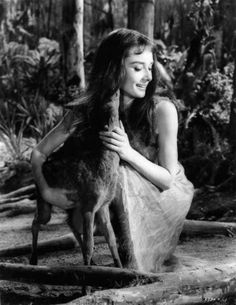 Audrey Hepburn and her pet fawn Ip on the at of Green Mansions c. 1959