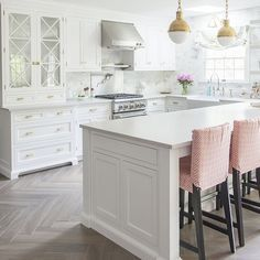 White kitchen with bleached hardwood flooring in herringbone pattern. Kitchen Flooring, Kitchen Furniture, Kitchen Decor, Kitchen Ideas, Luxury Interior Design, Interior Design Kitchen, Blue Kitchen Cabinets, Kitchens And Bedrooms, Home Decor Lights