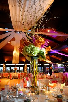 Truely beautiful ...funky centerpieces, colors & uplighting.