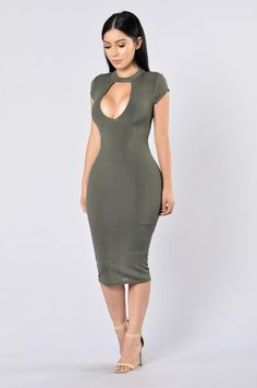 - Available in Black and Olive - Mock Neckline - Keyhole Front and Back - Midi Length - Form Fitting - Fully Lined - Made in USA - 94% Polyester, 6% Spandex