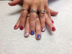 Red with blue and white with firework design accent nails  Oasis Salon and Spa Mill Hall Pa (570)726-6565