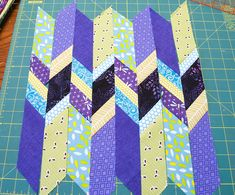 "Shattered Chevron Block: 12.5 Unfinished block: 5-20 different fabrics , 4- 2.25  x 12.5 "" strips of background fabric for the border."