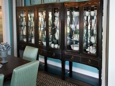 A concave dining chest, neoclassically inspired, served as a springboard for the room design. Interior halogen bulbs shine a spotlight on porcelain dinnerware and resin-cast white ribbon coral. Dining Room Hutch, Beach House Kitchens, Bedroom Pictures, Guest Bedrooms, Smart Home, Hgtv, My Dream Home, Home Decor Inspiration