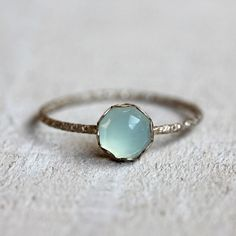 Aqua blue chalcedony gemstone ring. A brilliant and stunning rose cut blue chalcedony gemstone sits atop a patterned sterling silver band. Set is a scalloped sterling silver setting.  PLEASE NOTE THAT THIS RING IS VERY DELICATE! The color of the natural gemstone can vary some and the color can appear different depending on your screen. I do offer a free exchange if you aren't 100% satisfied with the ring's gemstone color. Just ask. :-)   The gem measures 6mm wide and the sterling silver band…