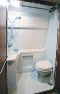 Small Shower Remodel Wood and Fiberglass Shower Remodeling Bathroom Makeovers. Toilet For Small Bathroom, Wet Room Bathroom, Bathroom Furniture, Small Bathrooms, Bathroom Storage, Bathroom Ideas, Tub To Shower Remodel, Small Showers, Wet Rooms