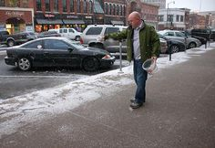 "Jeff Weaver, owner of Bambino's Restaurant, begins salting the sidewalks in front of his restaurant on Broadway on Wednesday, Jan. 19, 2011. Weaver says he ""learned his lesson"" from the last snowfall when he didn't salt the walkway before the snow accumulated. Photo by MELISSA KLAUDA / Missourian."