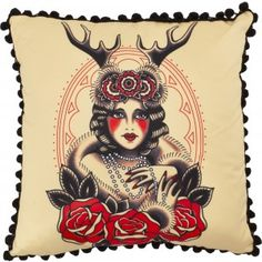 SOURPUSS LADY OF THE WOODS SATIN PILLOW  Add some Victorian inspiration to your home with the Lady of the Wood pillow. This cream satin pillow features an antlered lady dressed in pearls and fur, surrounded by roses and a decorative frame. Trimmed with black pom poms. Plain black backside.  $14.00