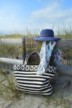 Perfect for the day at the beach! This oversized striped black and white bag CASINO features wide handles, Aztec trim, whimsical medallions details, and a snap close. Flaunt it with style on the beach this year! #asianeye #bag #fashion #trend #spring16 #summer16 #style #beach