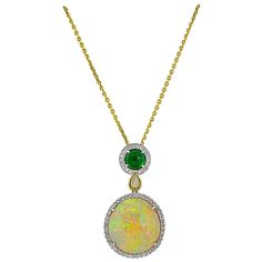 13.48 Carat Opal Tsavorite Garnet Diamond Gold Pendant | From a unique collection of vintage necklace enhancers at https://www.1stdibs.com/jewelry/necklaces/necklace-enhancers/