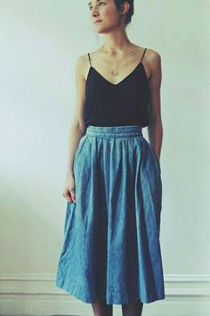 Denim skirt and black top
