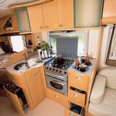 Interior of a European RV This stove is perfect but the sink is TOO small.