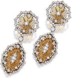 A pair of diamond and 18 karat bicolour goldearrings, by Buccellati, Italy. Of openwork design set with round diamonds weighing approximately 3.70 carats, mounted in white and yellow gold, pendants detachable, signed Buccellati, Italy. Sotheby's.