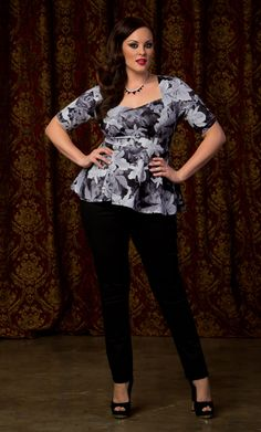 Go for a muted floral print this Fall like our plus size Posh Ponte Peplum Top in the Shadow Floral Print