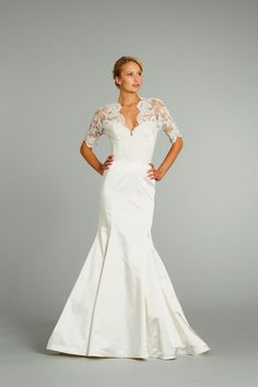 Lace sleeves & a subtle v-neck give this mermaid #wedding dress a sexy but church appropriate style.