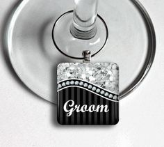 Bridal party wine charms. Available in BRIDE, GROOM, MAID OF HONOR, BEST MAN, BRIDESMAID, GROOMSMAN, MOTHER OF THE BRIDE, FATHER OF THE BRIDE, MOTHER OF THE GROOM, FATHER OF THE GROOM, and CHEERS.
