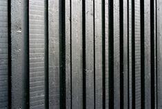 Alternating width, shou sugi ban reverse board & batten siding.- Villa Musu by Sanaksenaho Architect