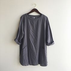 Urban outfitters linen pocket dress size small Bought it at urban outfitters. Extremely comfortable but sadly only worn twice. Has two pockets and is a stone gray color. Excellent condition with no damage. Urban Outfitters Dresses Mini