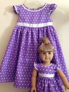 This listing is for 2 custom matching dresses - one for a little girl and one for her American Girl (or other 18) or Bibby Baby (or 15) doll. The dresses both feature a lined bodice, ruffled capped sleeve, raised waistline, gathered skirt, and attached grosgrain ribbon that ties in the